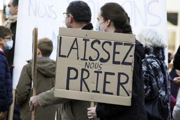Tighter restrictions have led to sporadic protests like one in Strasbourg  eastern France. The sign ...