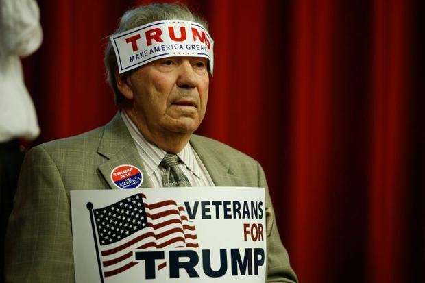A supporter of Republican presidential candidate Donald Trump attends a fundraising event in Lawrenc...