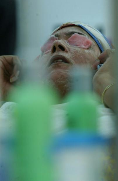 A woman in India undergoes a skin treatment