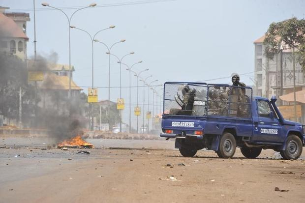 A Guinean gendarmerie vehicle drives along the street in Conakry during a protest called by the oppo...