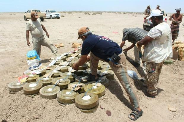 Yemeni security forces inspect unexploded ordnance confiscated from Al-Qaeda militants in the Lahj p...