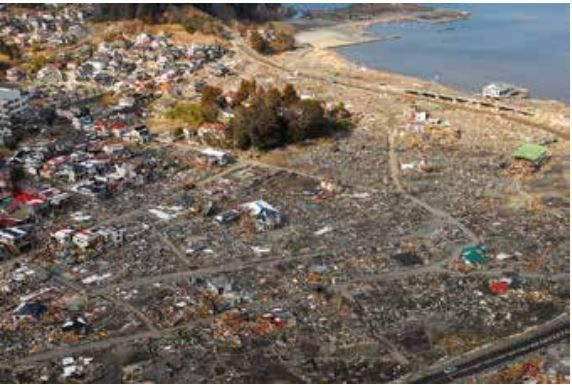 The tsunami resulting from the 2011 Tohoku earthquake destroyed the low-lying areas of tsuchi  Japan...