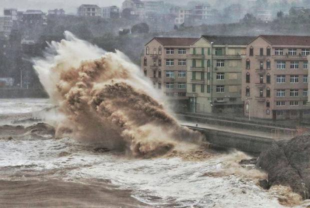 Waves hit a sea wall in Taizhou in China's eastern Zhejiang province  battered by Super Typhoon...