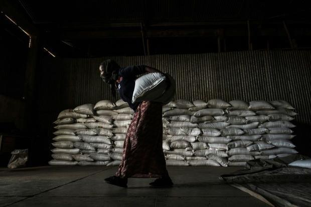 A woman in Alamata carries a sack of wheat during food distribution organised by the Ethiopian gover...