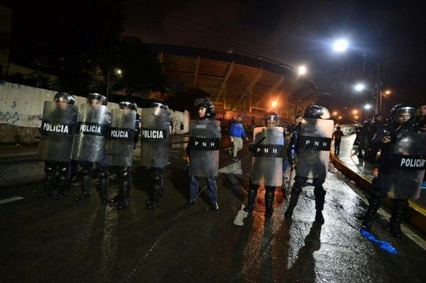 The riot is believed to have started when a bus carrying Motagua players was attacked