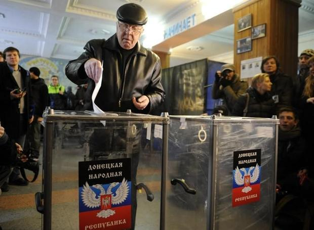 A man casts his ballot during the vote in polling station in eastern Ukrainian city of Donetsk on No...