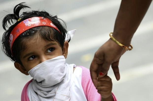 India is gradually easing a nationwide lockdown despite setting a daily record of 18 500 new cases a...