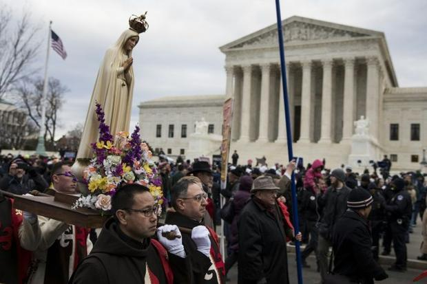 Pro-life demonstrators march in front of the US Supreme Court during the 44th annual March for Life ...