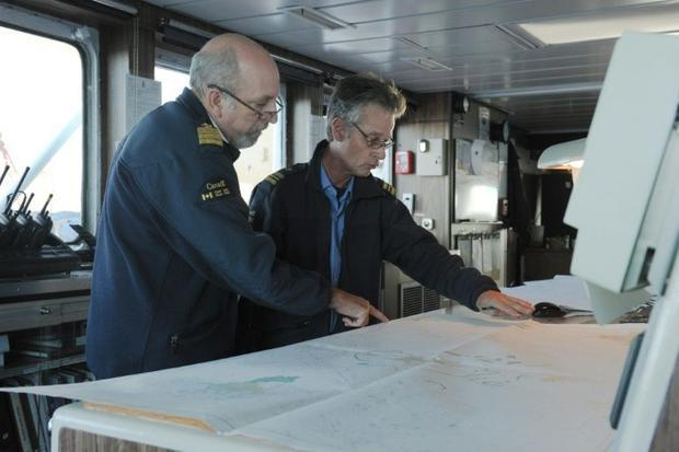 Captain Alain Lacerte (L)  working with First Lieutenant Jocelyn Dugas on charting the course throug...