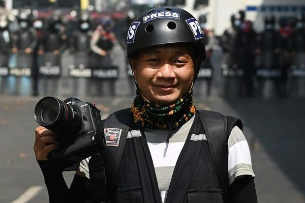 Associated Press (AP) photographer Thein Zaw posing for a photo during his coverage of demonstration...