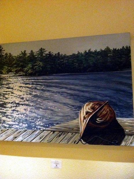 Inside Deerhurst Resort in Ontario  a piece of Muskoka-esque art called Moonlit Canoe by Ellen Cowie