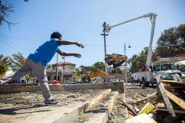 The Carnival parade grandstands in a central square in Port-au-Prince went up in flames after a poli...