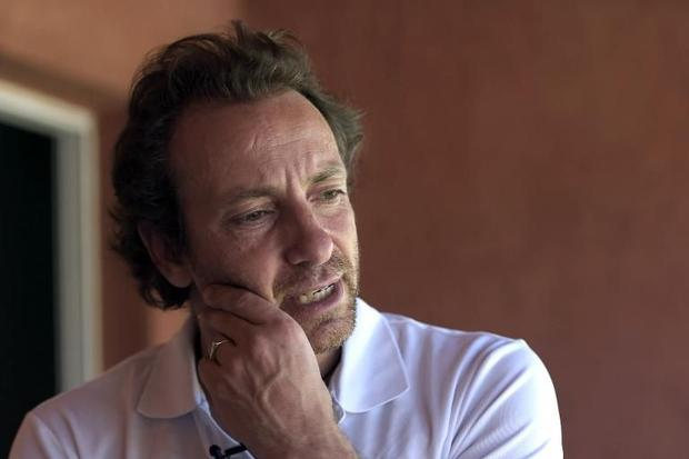 Former Olympic champion Philippe Candeloro talks with AFP at the hotel where the remaining French at...