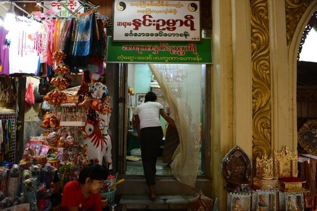 A man enters a fortune teller's shop in Yangon on November 7  2015