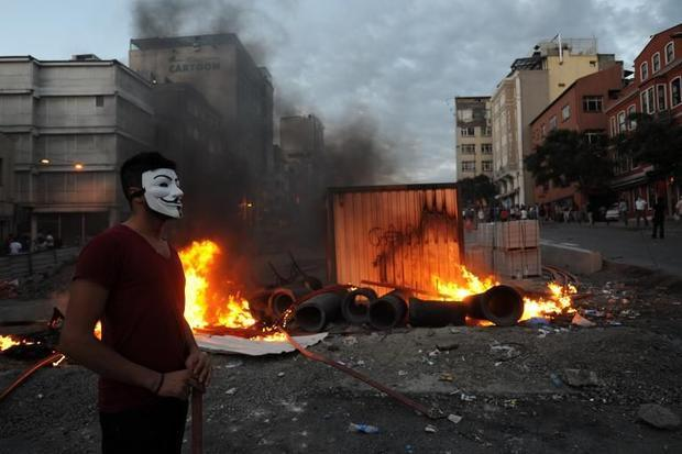 A Turkish demonstrator wears a Guy Fawkes mask during a protest against the demolition of Gezi Park ...