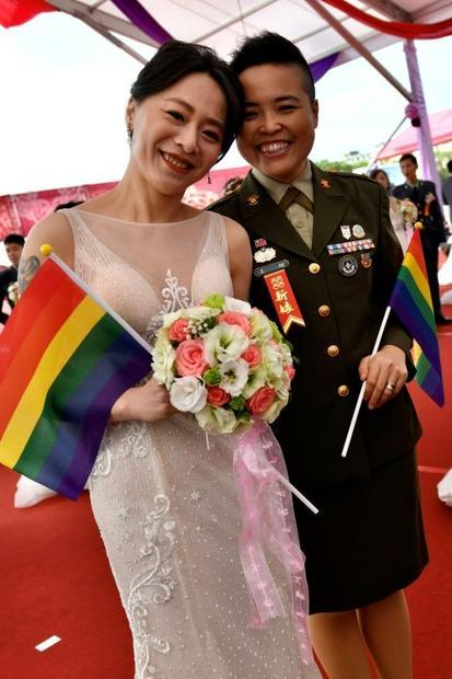 Yi Wang (R) and Yumi Meng were among the first same-sex couples to get married in a mass wedding hel...