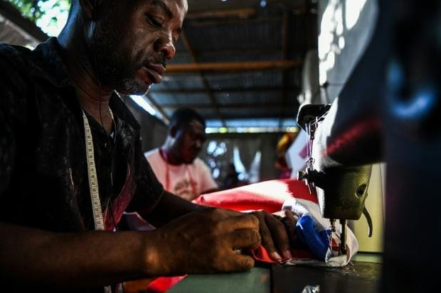 Tailors work on Carnival costumes in Port-au-Prince