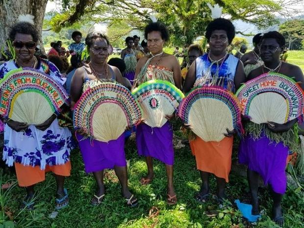 Women in tribal colours take part in a reconciliation ceremony -- part of efforts to ensure a bright...