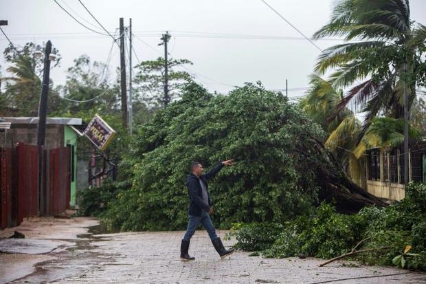 A man points to fallen trees as Hurricane Eta makes landfall in Bilwi  on Nicaragua's northeast...