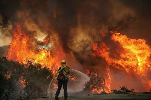 San Miguel County Firefighters battle a brush fire along Japatul Road during the Valley Fire in Jamu...