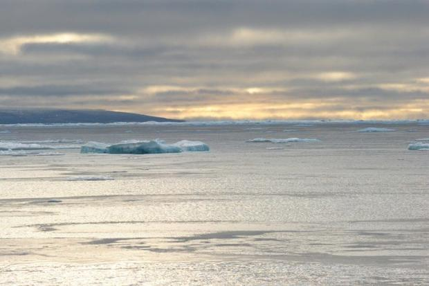 Ice chunks can be seen in the Northwest Passage near the CCGS Amundsen  a Canadian research ice brea...
