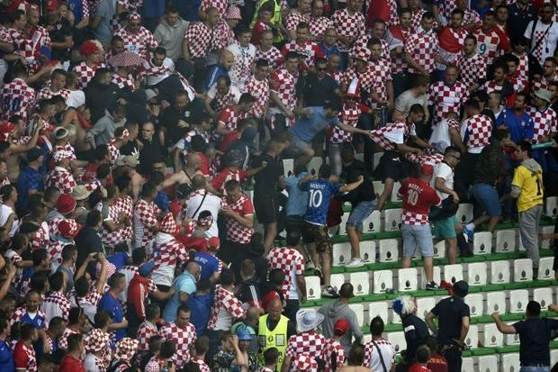 A fight breaks out during the Euro 2016 group D match between Czech Republic and Croatia