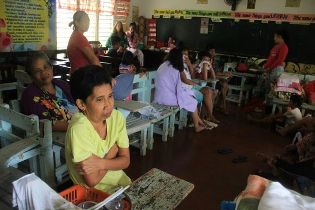 Residents shelter in a classroom used as an evacuation centre in Camalig  Albay province