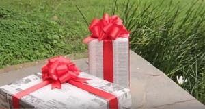 Gifts wrapped using newspaper pages.