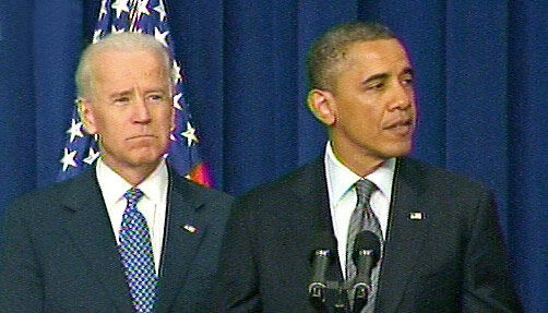President Barack Obama speaking with Vice-President Joe Biden about the new gun control measures the...