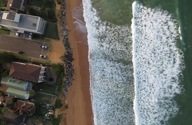 This is a drone aerial view of Narrabeen Beach in north Sydney before a storm in April 2015.
